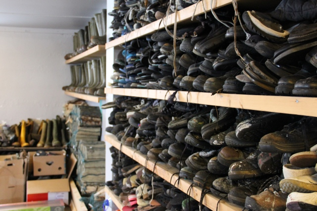shoes sorted, stacked and waiting to be turned into art